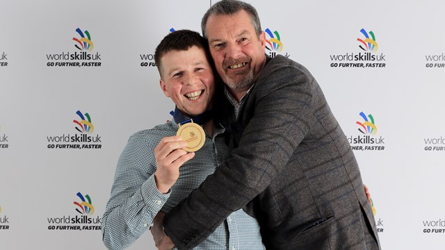 MATTHEW WOOD GOLD WITH STEVE SMITH.jpg