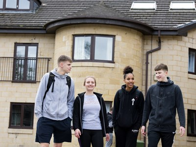 Myerscough College students walking outside a halls of residence.